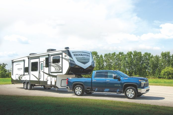 Blue truck pulling Brookstone fifth wheel trailer